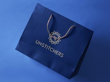 Unstitchers Clothing Brand Logo