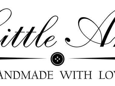 winning logo for baby\'s clothing range