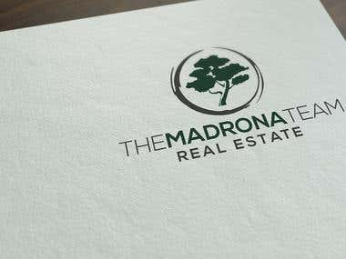 The Madrona Group Real Estate logo