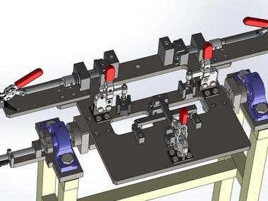 R E M co. A fixture to weld auto parts.