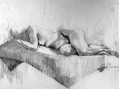 Pencil drawing of lying model.