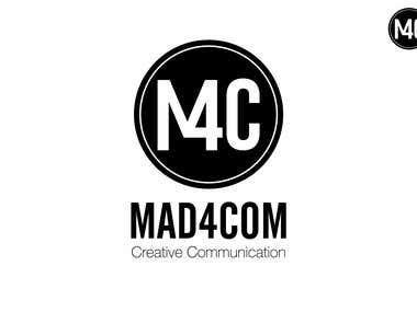 """Logo """"Mad 4 Com"""""""