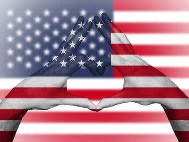 USA flag painted onto human hands with flag backdrop