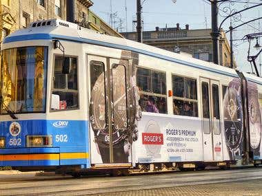 Taking photos of an advertisement on a tram