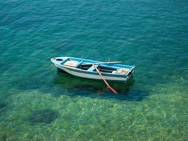 The Boat in the Azure Sea