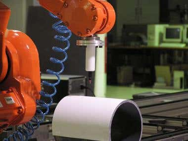ABB robots writing on cilindrical surface