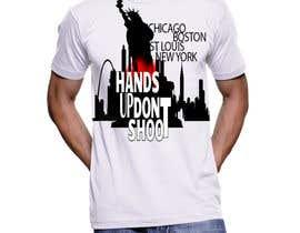 wajahathkhan tarafından Design a T-Shirt for Hands Up Dont Shoot Campaign için no 31