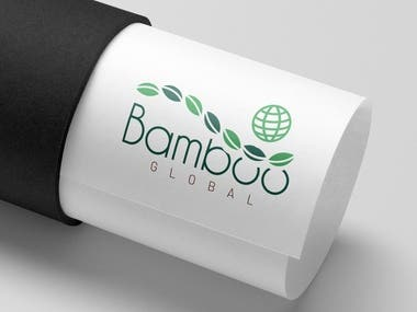 Bamboo Global is a team of enthusiasts fighting against air pollution by planting bamboo trees in every place in the world. Bamboo trees produce high amounts of oxygen, and Bamboo Global has invented a strategy to raise them with minimal CO2 emissions.  The vision for this brand is to share this ambition with like-minded people so they can connect and grow a society, represented by a suitable logo.  The design of the iconic mark is a combination of both a chain of leaves and a sphere. A whirl of leaflets symbolizes continuous progress, one tree at a time, while the globe emphasizes the worldwide importance of the mission.  As for the typeface, I chose a straightforward geometrical font that subtly resembles the branches of the Bamboo plant.  For colors, I chose a dull shade of green to express fresh oxygen and Bamboo stems, contrasted with a light green to speak of a clean environment. Lastly, I added a tone of brown to the lowermost text to convey the company's eco-friendly approach.