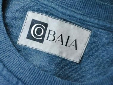 """Cobaia is the Portuguese word for """"Guinea Pig"""" and the name of a new clothing line targeted at young upper-class people between 15 and 30. The core values for this brand were experimentation, innovation, ahead of its time, and leading.   My idea was to only use a typeface instead of depicting an animal. The guinea pig walks in a very flexible manner and behaves almost like a curve, something I kept in mind while choosing the font. I presented three wordmark ideas, which all hint at experimentation and quality.  The first idea is a letter C wrapping around the letter O to suggest """"experimenting with different clothing"""" as a core value, using a lucrative font.  The second idea was the same concept but executed differently, with the syllables CO and BAIA separated and in contrast to each other to communicate """"trying a new combination.""""  The last idea was a more futuristic approach, with a geometric font for a contemporary look and yet another combination of t"""