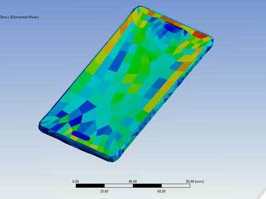 Drop test analysis of mobile phone is conducted using ansys explicit dynamics module.Drop scenario is simulated by considering 4 feet drop height.Weight & materials for mobile body components are modeled as per product specification.