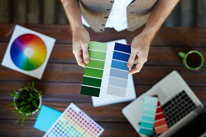 man holding color gradient papers